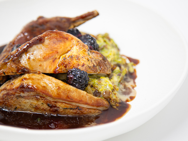Roasted pheasant breast, confit leg, creamed sprouts and chestnuts, pheasant and port jus with blackberries