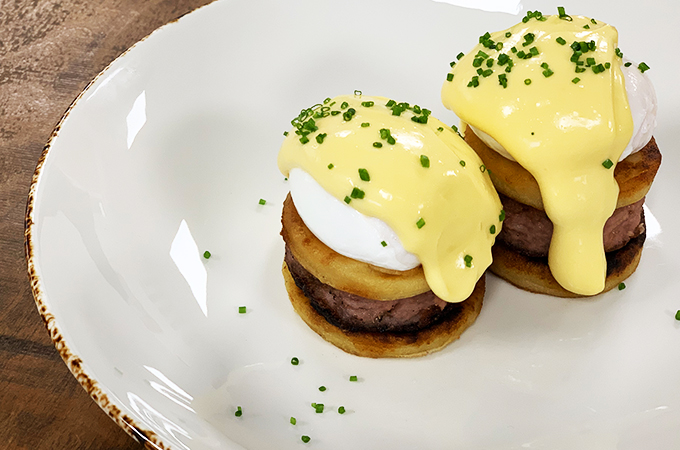 Tattie scones, Lorne sausage, slow cooked eggs and whisky hollandaise